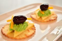 Two canopes. Savoury canope biscuits on a platter stock image