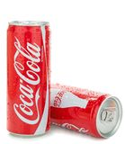 Two cans of Coca Cola. NIEDERSACHSEN, GERMANY AUGUST 10, 2014: Thin style 0,33 liter cans of coca cola soft drink with water droplets on a white background Royalty Free Stock Photography