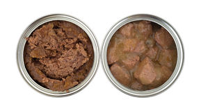 Two cans of opened dog food. Top view of beef and chicken dog food cans opened on a white background Royalty Free Stock Image