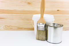 Two cans of paint with brush Royalty Free Stock Images