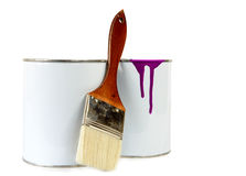 Two cans of paint and a brush Stock Image