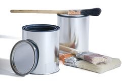 Two Cans Three Brushes. Two brand new silver paint cans with 3 brushes isolated on a white background with a clipping path Royalty Free Stock Photos