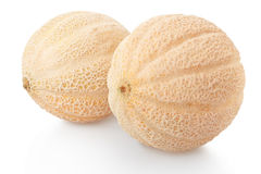 Two cantaloupe melons on white Stock Photography