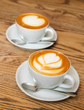Two cappuccino cups Royalty Free Stock Images
