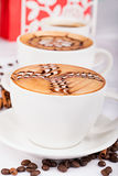 Two cappuccino cups Royalty Free Stock Photos