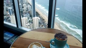 Two cappuccinos and a view over the Gold Coast in Australia. Two cappuccinos and an awesome view over the Gold Coast in Australia stock video footage