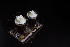 Two caps of coffe with whipped cream Stock Photo