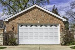 Two car garage. Traditional two car brick garage Stock Photos