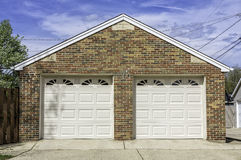 Two car garage. Traditional two car brick garage Royalty Free Stock Photos