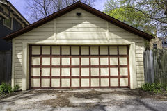 Two car garage. Traditional two car wooden garage Royalty Free Stock Image