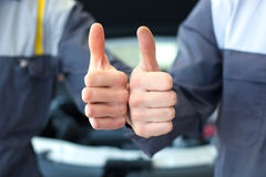 Two car mechanic hands. Thumbs up Royalty Free Stock Photography