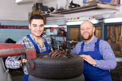 Two car mechanics at workshop Stock Image