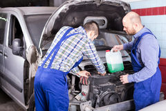 Two car mechanics at workshop Stock Photo