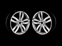 Two car wheel rims in dramatic light stock photos