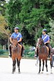 Two Carabinieri, Italian horse police on patrol in the city park Stock Photography