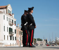 Two carabinieri or police stand obrserving. Royalty Free Stock Photo