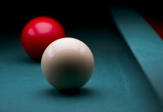 Two carambole billiards balls. White and red carom balls with dark backgroud Stock Image