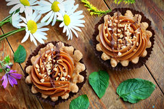 Two caramel cupcakes. Close up of caramel shortbread cupcakes with nuts Stock Image