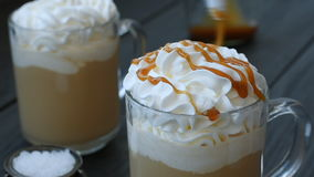 Two caramel latte with salt stock footage