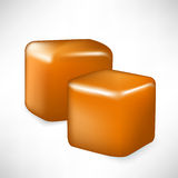 Two caramel pieces. Cube shaped Stock Photos