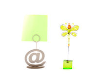 Two card holders. The at sign and green butterfly over white royalty free stock photos