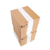 Two cardboard boxes with standard black signs Royalty Free Stock Photos