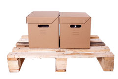 Two cardboard boxes on Wooden palette Royalty Free Stock Image
