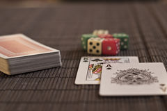 Two cards near deck with dices Royalty Free Stock Images