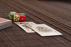 Two cards near deck with dices Stock Image