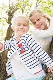 Two carefree little girls in the spring park Royalty Free Stock Image