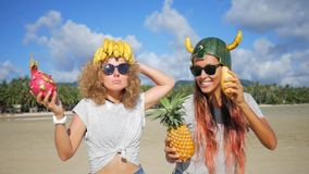 Two Carefree Young Girls Fooling on the Beach and Dancing with Exotic Thai Fruits. Vegan Dance. Phangan, Thailand. HD stock footage