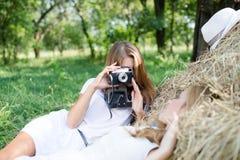 Two carefree young girls having fun taking Stock Image