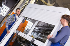 Two careful workers inspecting windows Royalty Free Stock Photos