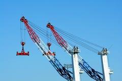 Two cargo container cranes Royalty Free Stock Photos