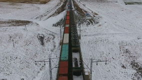 Two cargo trains goes towards each other delivering goods, fuel, petrolium in winter. stock video