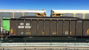 Two Cargo Trains Pass stock video footage