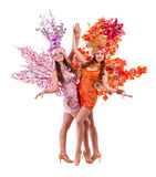 Two carnival dancer women dancing against isolated Royalty Free Stock Photos