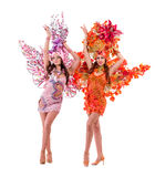 Two carnival dancer women dancing against isolated Stock Photography