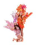 Two carnival dancer women dancing against isolated Royalty Free Stock Photography