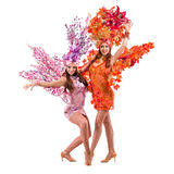 Two carnival dancer women dancing against isolated white Royalty Free Stock Photography
