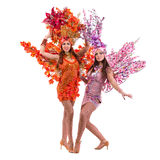 Two carnival dancer women dancing against isolated white Stock Photography