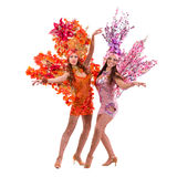 Two carnival dancer women dancing against isolated white Royalty Free Stock Images
