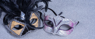 Two carnival masks with feathers   on glitter Stock Photos