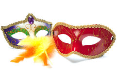 Two carnival masks and feathers Stock Images