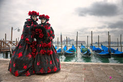 Two carnival Masks in San Marco, Venice. Stock Image