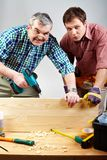 Two carpenters Royalty Free Stock Images