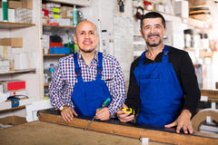 Two carpenters at joiners shop Royalty Free Stock Photography