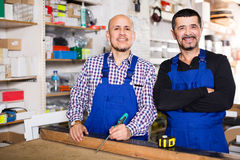 Two carpenters at joiners shop Royalty Free Stock Images