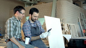 Two carpenters makes selfie in workshop stock footage