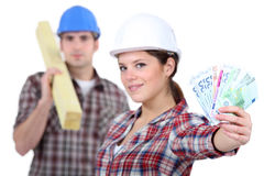 Two carpenters making money Stock Photos